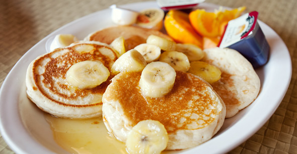 Buttery Banana Hotcakes with Fresh Fruit at the Bus Terminal Diner in Toronto