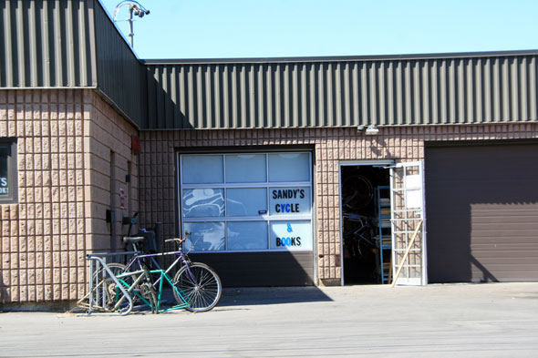 Sandy 39 s cycle and book shop for Tattoo shops etobicoke