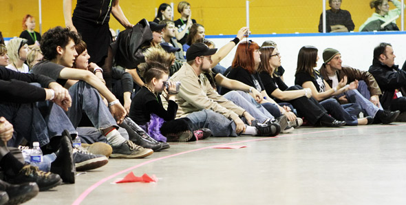 Toronto Roller Derby fans look on...