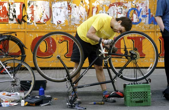 Toronto Bike's Dan T. fixes a bike in Kensington Market