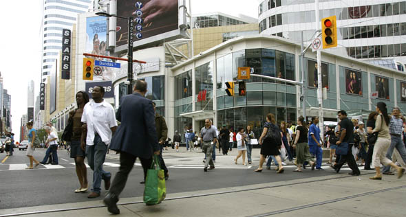 Pedestrians Scramble at Yonge & Dundas Intersection in Toronto