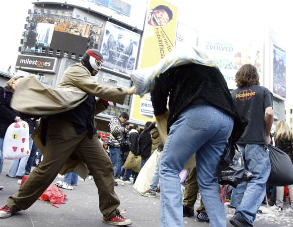 Saajid Motala dressed in a Mexican wrestling mask during the pillow fight in Yonge-Dundas Square in Toronto 2009