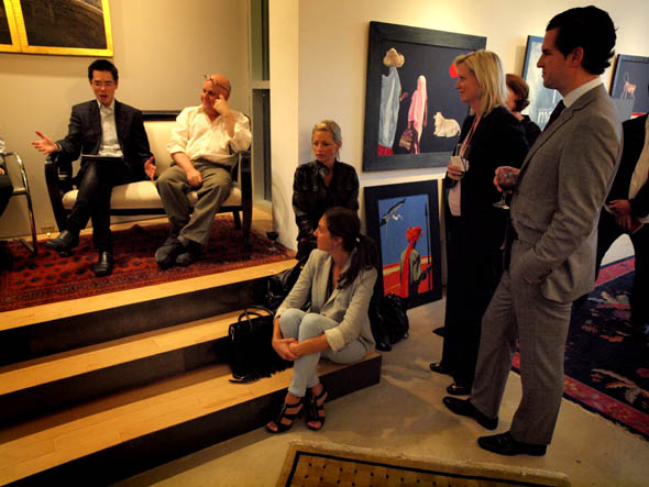 Charles Pachter and Derek Wong talk to guests at Art Of Living event