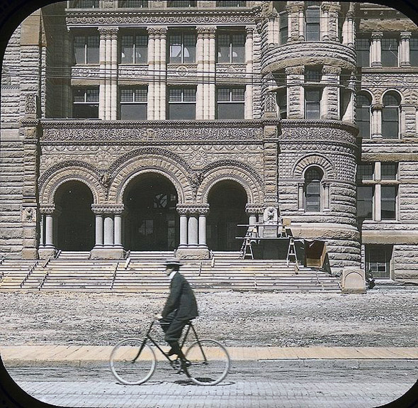 2011322-1899-Cyclist_passing_city_hall.jpg