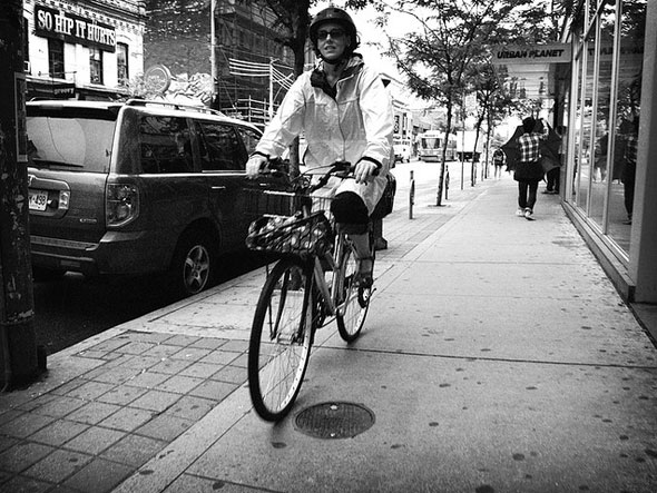 toronto cyclist riding on the sidewalk