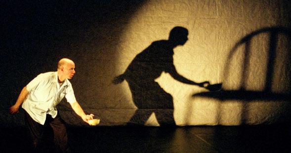 Rough House- Andy Massingham plays with Rebecca Picherack's and Michelle Ramsay's Dora Award-winning lighting design.  Photo: John Lauener