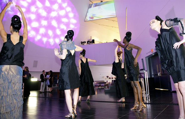 Models strike a pose during The Night of the Avant Garde at The ROM