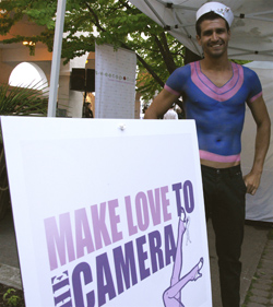 Sailor makes love to the camera at Hello Sailor fundraiser for Rethink Breast Cancer