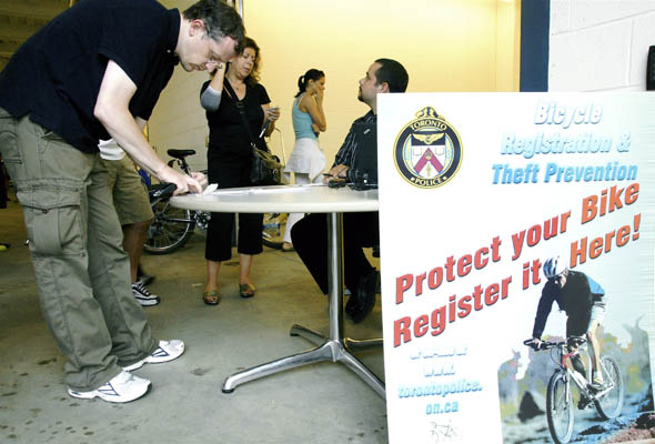 Owners of stolen bicycles register their bikes at Toronto Police open house