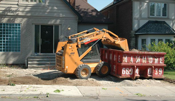 Bobcat Removes Driveway