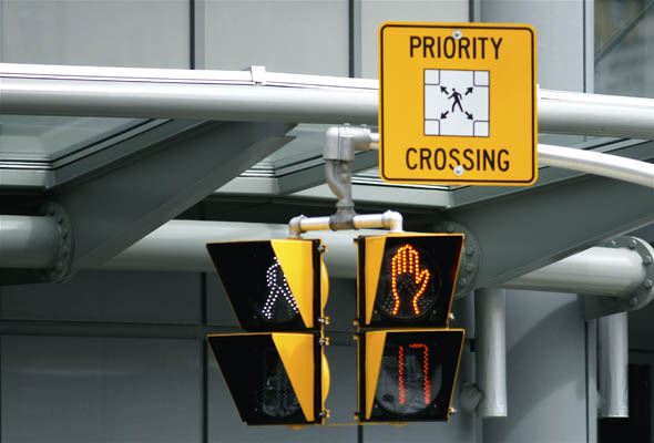 Priority Crossing sign at the new scramble pedestrian crossing at Yonge and Dundas in Toronto