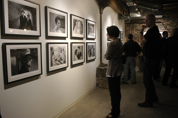 Attendees looking at Raging Bull pictures