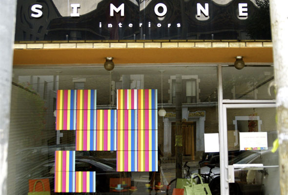 Simone Interiors window featuring the art installation of Lin Gibson
