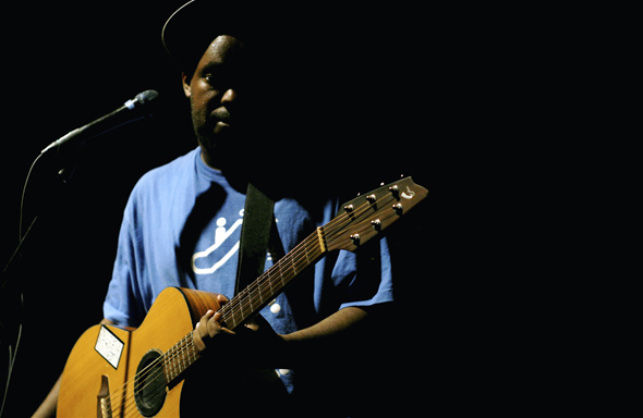 Shad performs with acoustic guitar at The Mod Club in Toronto