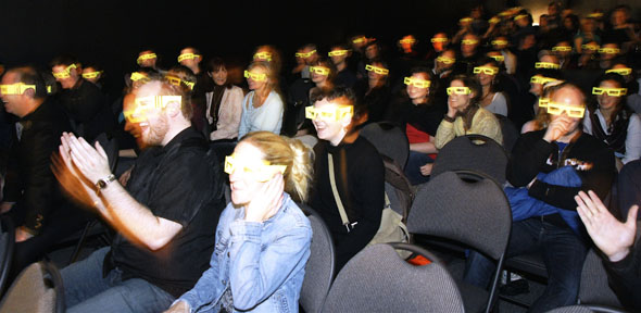 The Comedy Bar's Grand Opening in Toronto, with the audience watching in Bee Vision