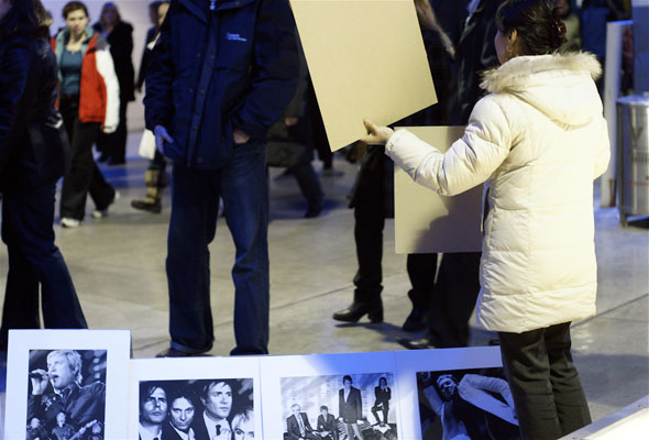 Duran Duran rip-off artist selling prints of the band after the show at the ACC in Toronto