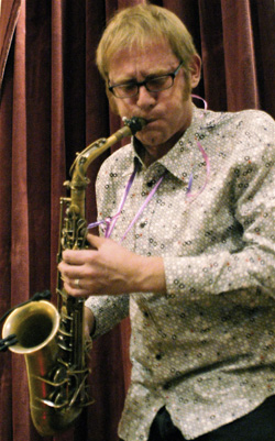 Richard Underhill plays the saxophone at Spacing magazine's fifth anniversary party in Toronto