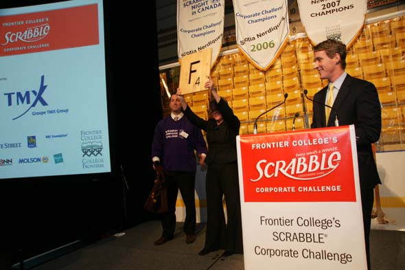 The ceremonial drawing of the first tile at Frontier College's Scrabble Corporate Challenge