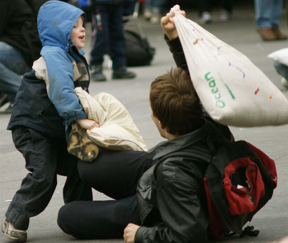 Kids having fun at the pillow fight at Yonge-Dundas Square in Toronto 2009