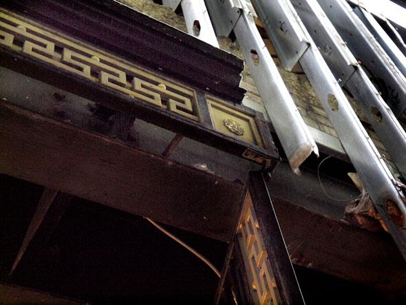 A Versace detail clings to the door of 83 Bloor West