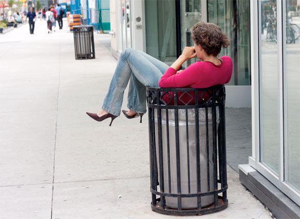 sitting in garbage can