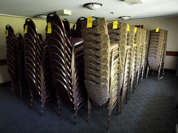 Room of chairs for auction at the Valhalla Inn.