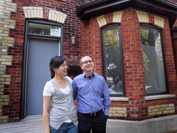 Danielle Lam-Kukzak and Joe Troppman in front of their home