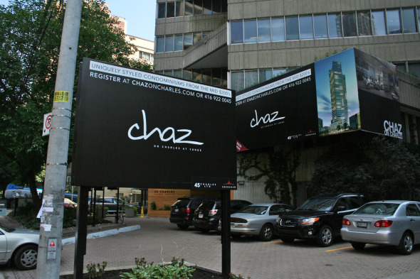 Chaz signs outside of 45 Charles Street East