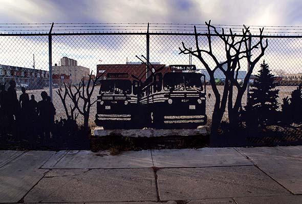 artwork on fence around former TTC car barns