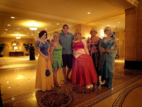 Christopher Heard with Disney princesses in the lobby of the Royal York Hotel