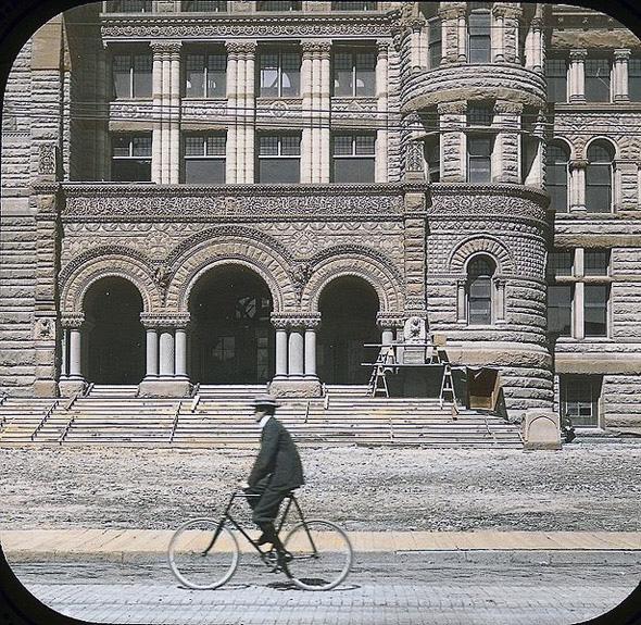 2011322-1899-Cyclist_passing_city_hall.jpg