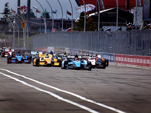 Cars head down the straight into turn one