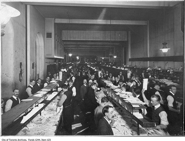 201413-postal-workers-sorting-1900s.jpg
