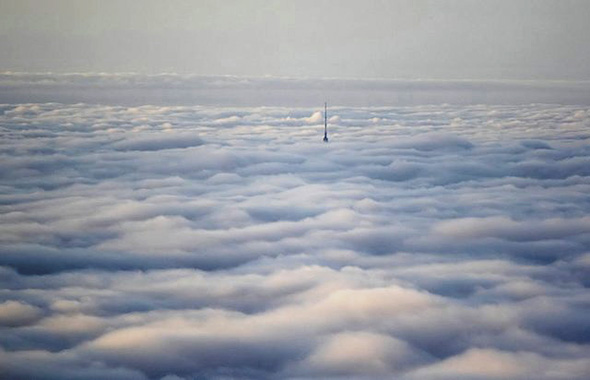 CN Tower above clouds